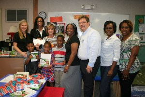 City of Ridgeland Community Awareness Committee members delivered donations to the art classroom at Ann Smith Elementary in Ridgeland. Art teacher Ms. Green accepted the donations including money from committee members, a check from BankPlus, and art supplies from Wal-Mart Supercenter in Ridgeland, a member of the Ridgeland Chamber of Commerce. Pictured, back row left to right, are Ann Smith Elementary principal Dr. Melissa Philley, Community Awareness Committee member Shelia Jackson, Ann Smith Elementary art teacher Rhonda Green, Community Awareness Committee member Lazaire Martin, Community Awareness Committee chairman Drew Malone, Ann Smith PTO vice president Evelyn Williams, and Ann Smith PTO president Trenyse Small. Front row, left to right are Ann Smith Elementary students from Ms. Caver's first grade class, Noah Bryant, Kasydie Byars, and Jacobie Dobbins.