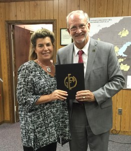 City Clerk Paula Tierce and Mayor Gene McGee pose with the Certificate of Achievement for Excellence in Financial Reporting awarded to the City of Ridgeland for its comprehensive annual financial report. The Certificate of Achievement is the highest form of recognition in the area of governmental accounting and financial reporting, and its attainment represents a significant accomplishment by a government and its management. It is awarded by the Government Finance Officers Association of the United States and Canada (GFOA).