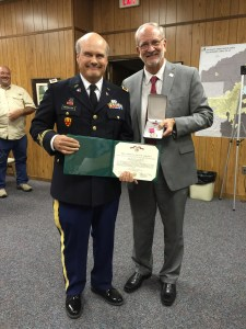 Colonel John M. McCollum is presented with the Legion of Merit award at the June 2, 2015 City of Ridgeland Mayor and Board of Aldermen meeting by Mayor Gene McGee. Colonel McCollum who serves as the City of Ridgeland Public Works Director was recognized with the award upon retirement from a 31-year career with the United States Army. At the culmination of his military career, McCollum was holding the position of Executive Officer of the 4010 United States Army Hospital with the Army Reserve Medical Command. His outstanding leadership, technical competence and distinctive accomplishments contributed immeasurably to the Army. He is recognized for distinguished performance of duty that represents exemplary service in the finest tradition of the United States Army.