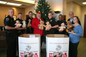 Stuffed animals were donated to the Ridgeland Police Department today to give to children in need of comfort as a result of domestic disputes or other incidents. Pictured from left to right are Ridgeland Police Chief John Neal, Lt. Brian Myers, Officer Daniel Stevens, Toys for Tots Coordinator Ron Polk, Officer Justin Crawford, Officer James Myers, Mayor Gene McGee, and Officer Heather Evans.