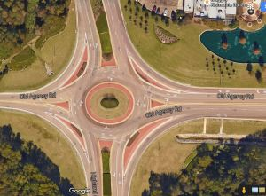 The multi-lane roundabout in Ridgeland, Mississippi is located at the intersection of Old Agency Road and Highland Colony Parkway. Interstate 55 and the Old Agency exit is to the east of this image. Renaissance at Colony Park is located in the northeast corner. St. Andrew's Episcopal School is located in the northwest corner, and the Natchez Trace Parkway is directly south of the roundabout.