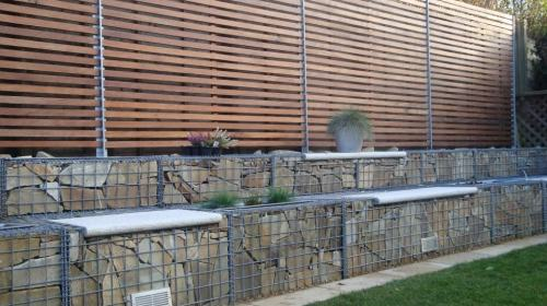 Concertainer gabions being used for a feature wall with seats.
