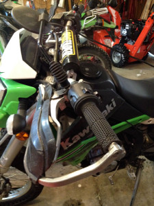 dual sport grips, Pro taper handlebar, and folding mirror.