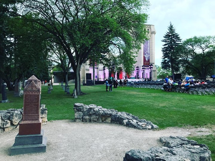 View from the tomb of Louis Riel, of the stage on the front steps of Winnipeg's St. Boniface Cathedral. Tonight there will be a gala concert celebrating the Cathedral's 200th anniversary, featuring top performers from Canada. There will be a portion of the show broadcast from Riel's tomb. Livestream here, starts at 8 pm CST: https://saltandlighttv.org/live/