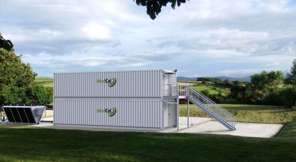 Secure I.T. Environments Ltd's ModCel containerised data centre installed on concrete plinth in grass field