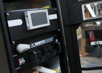 Open front of a modular UPS showing control panel and battery module