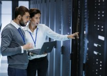 workers in a datacentre server room questions to ask your UPS maintenance provider