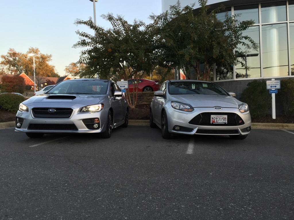 2015 Subaru WRX next to Ford Focus ST