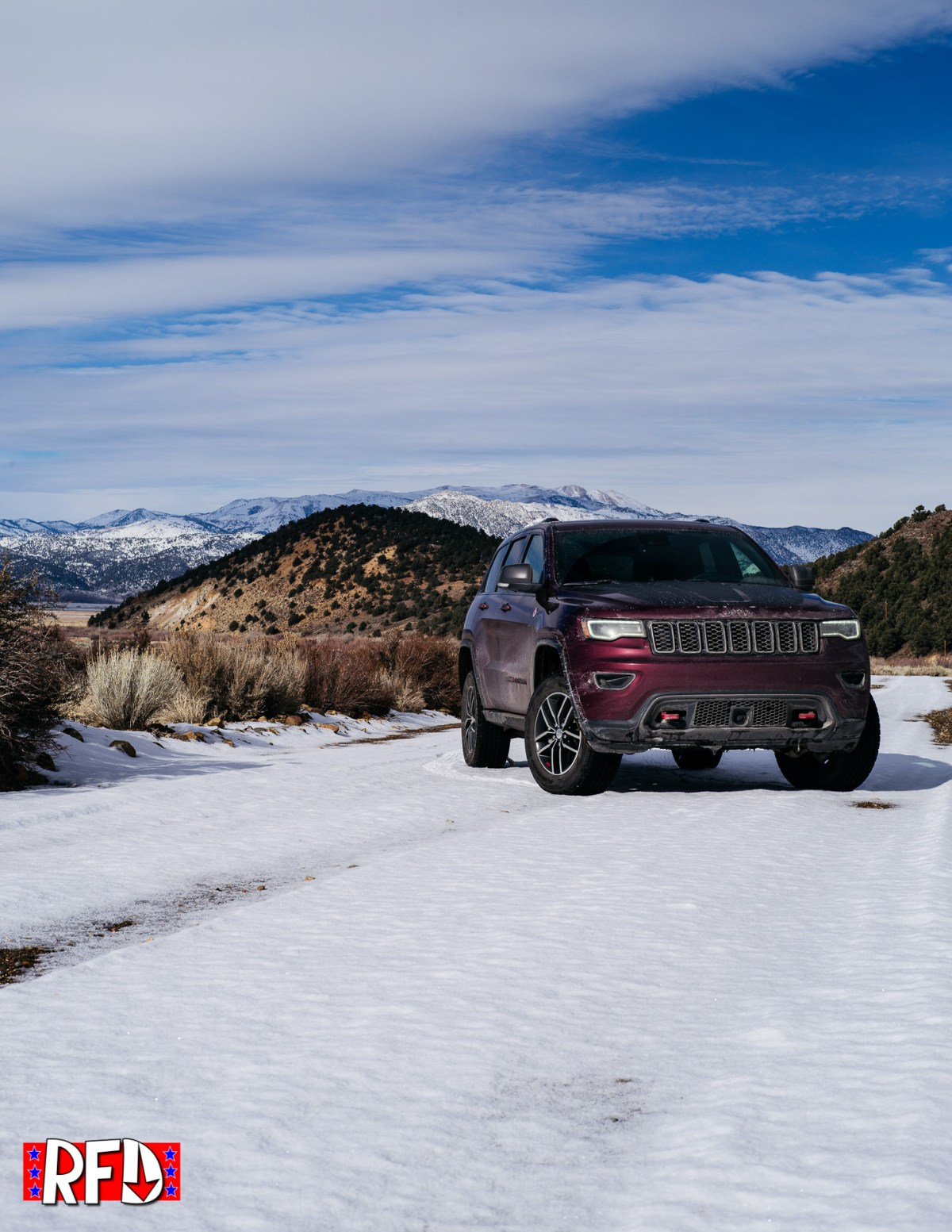 Jeep Grand Cherokee Trailhawk on snowy dirt road