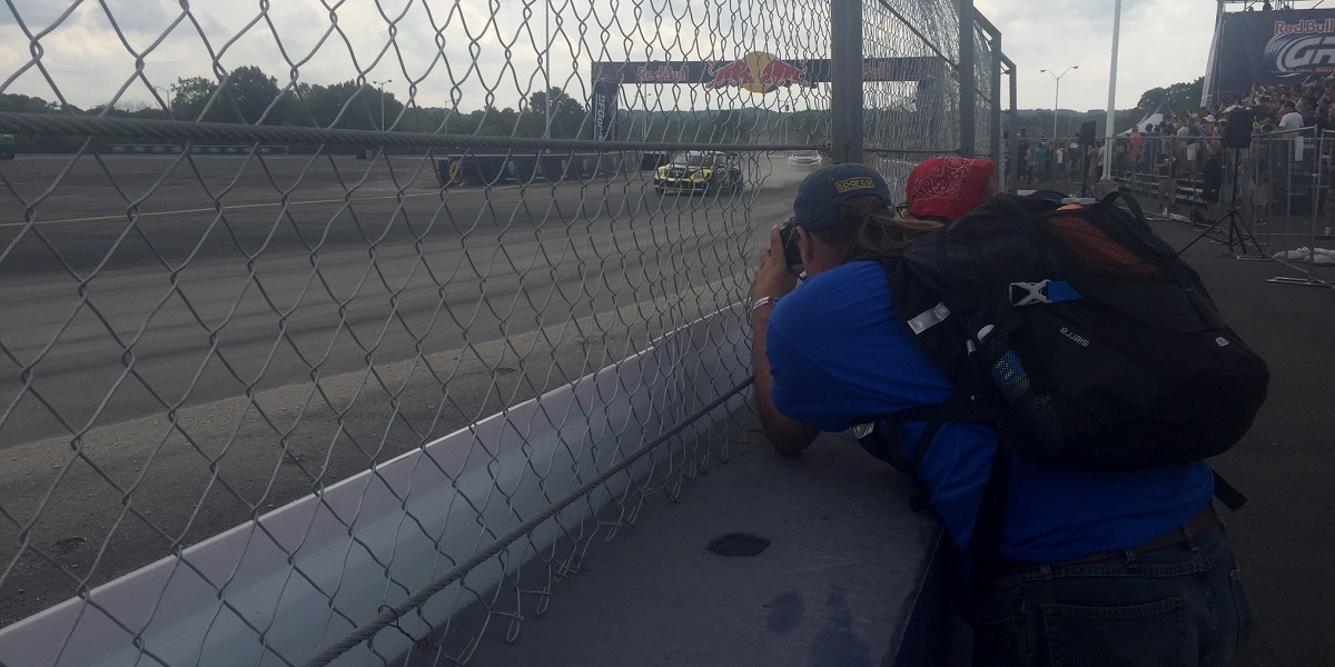 Justin and Elana snapping a photo of Tanner Foust