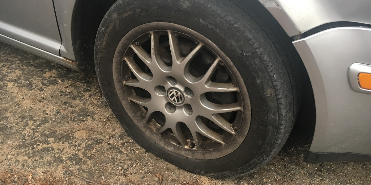 VW Jetta with flat tire