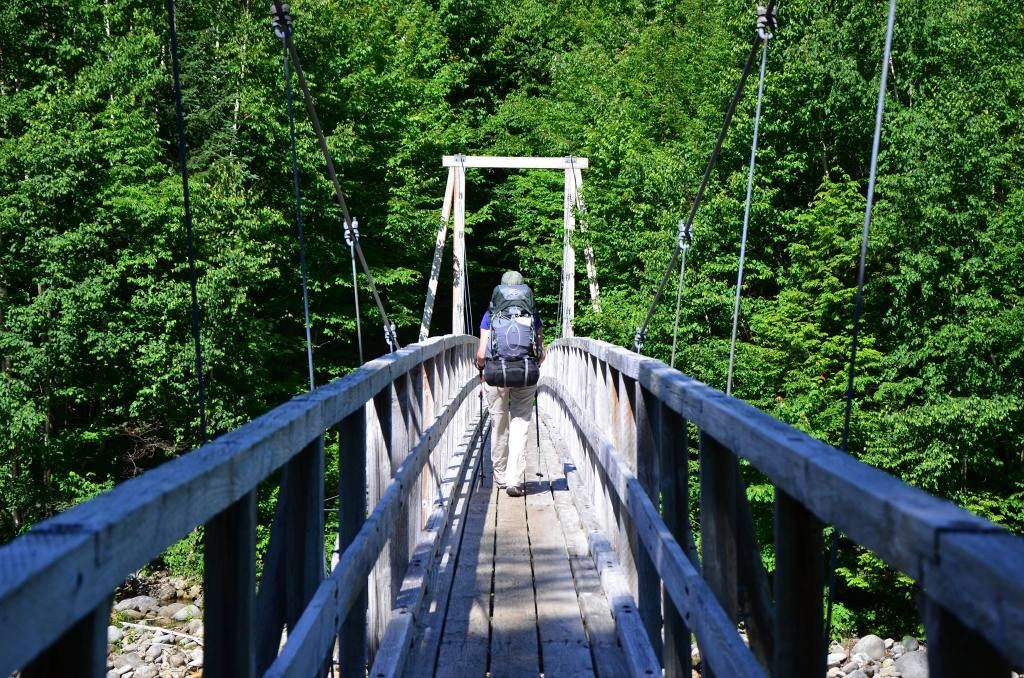 My friend Lagena walking across a bridge in New Hampshire.