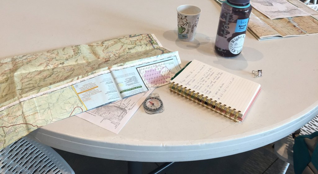 A map and compass on a table during a land navigation class