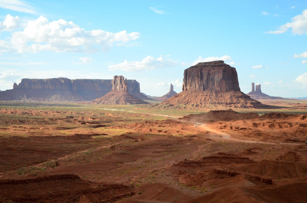Vehicle make their way around Valley Drive at Monument Valley Navajo Tribal Park