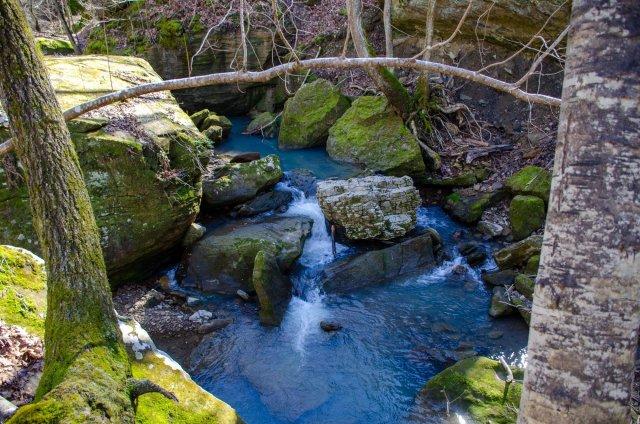water cascades down the creek