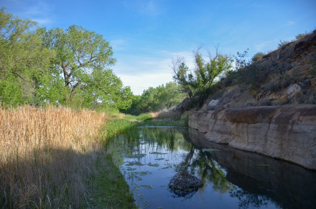 A creek is shown at Black Mesa State Park