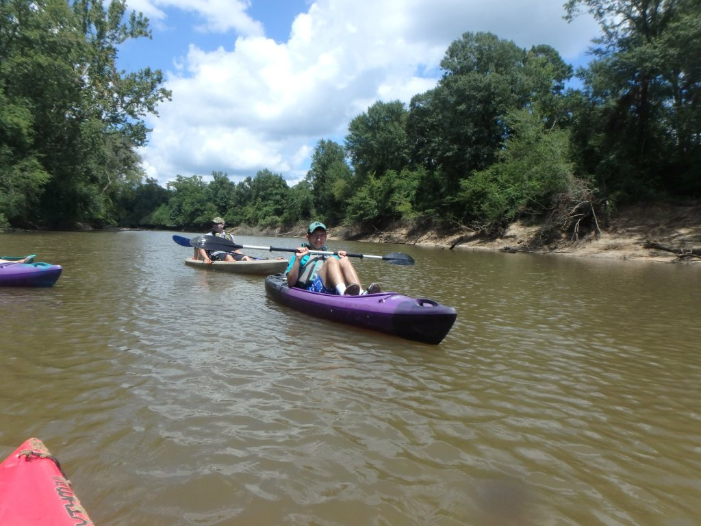 Nephew Noah and my brother float the river