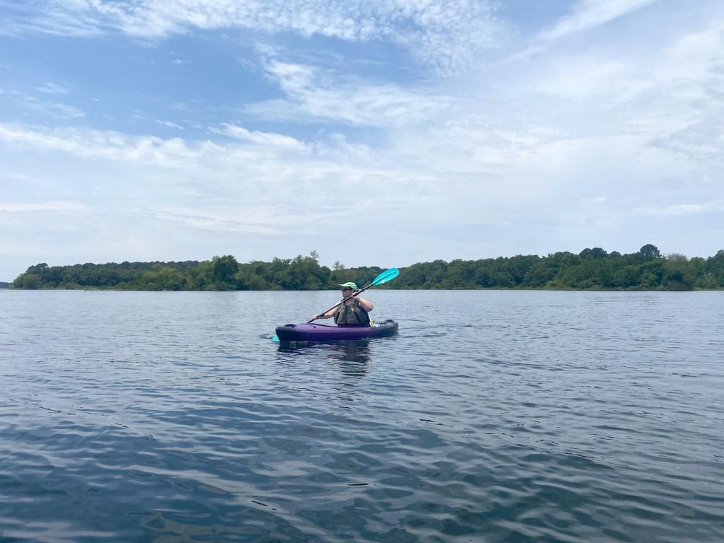 A woman paddles at DeGray Lake