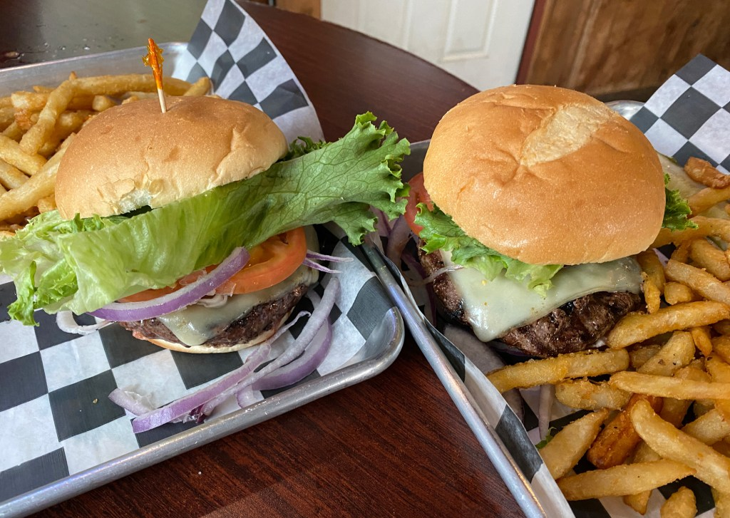 An elk burger and bison burger are shown