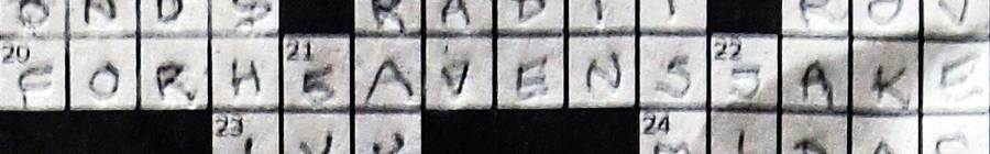 "Crossword puzzle detail with answer ""for heaven's sake."""