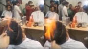 barber sets clients hair fire