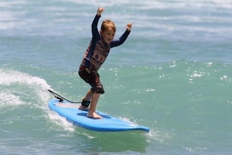 """Age 6, at Waikiki, catching my first wave, """"Shakka, Brah!"""""""