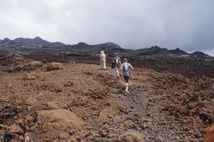 Older reddish-Brown lava below our feet, newer black lava in front.