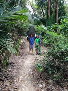 Hiking through the jungle to get to Burros surf spot