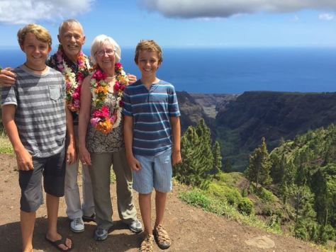 Rosie, Ron, Bryce and Trent posing in front of Nuku Hiva's Grand Canyon on the way to Taiohae