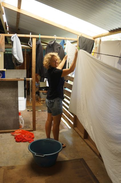 Leslie doing the weekly laundry at a friend's house