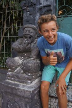 Trent Rigney impersonating a funny statuette at P.ura Ulun Danu Bratan