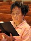 Senior woman reading bible in church