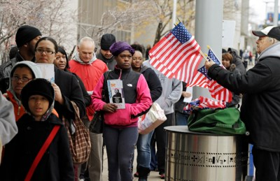 FILE - In this Nov. 5, 2012, file photo, voters wait in line outside the Cuyahoga County Board of Elections in Cleveland on the final day of early voting. Early voting won't be starting in Ohio on Tuesday, Sept. 30, 2014, following an order from a divided U.S. Supreme Court that delayed it until next week. (AP Photo/Mark Duncan, File)