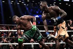 Deontay Wilder (right) drops a bomb on Luis Ortiz. Photo by Amanda Westcott/SHOWTIME
