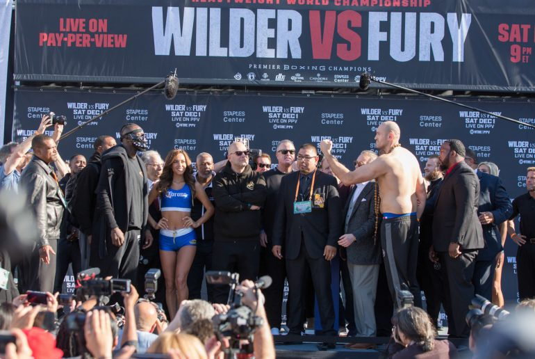 Fury Wilder 2 Weight . Deontay Wilder Tyson Fury Show Off Vastly Different Physiques At Festive Weigh In The Ring