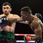 Richard Commey (right) clocks Isa Chaniev. Photo cxredit: Mikey Williams/Top Rank