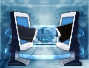 Computer Monitors Shaking Hands
