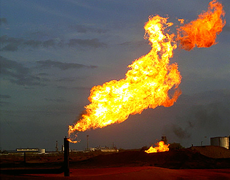 Photo of natural gas fire by Tod Baker for an article by the Rio Grande Sierra Club about oil and gas risks in New Mexico