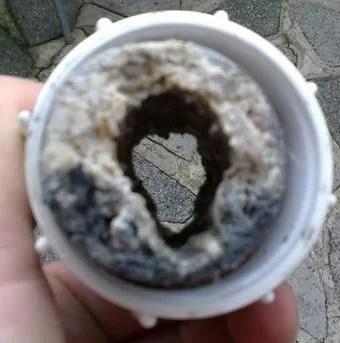 Verstopte wasmachine riool reinigingsdienst de vos