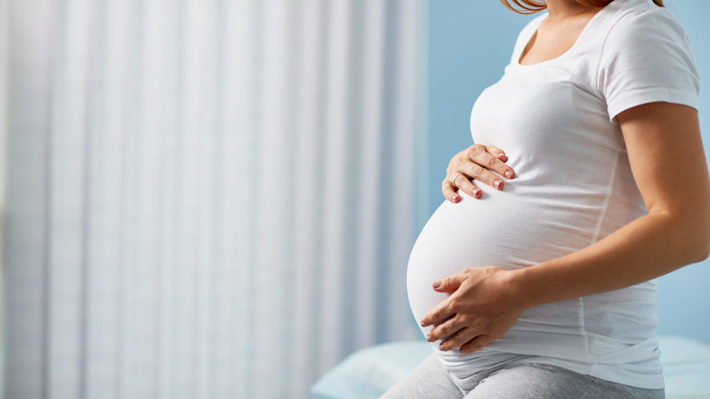 picture of a pregnant woman holding her belly