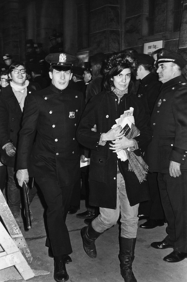 Fred W. McDarrah: Police arrest author and activist Susan Sontag during a draft protest at the Whitehall Army Induction Center, December 5, 1967