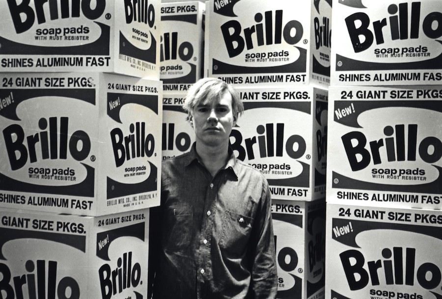 "Fred W. McDarrah: Andy Warhol at the opening of his exhibition, ""The Personality of the Artist,"" at the Stable Gallery, 33 East 74th St., April 21, 1964"