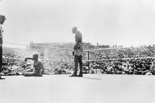 Jack Johnson pummels Jim Jeffries to win their Independence Day fight, 1910.