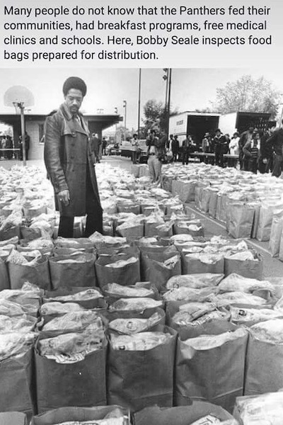 Bobby Seale Checks Food Bags. March 31, 1972. Photo by Howard Erker.