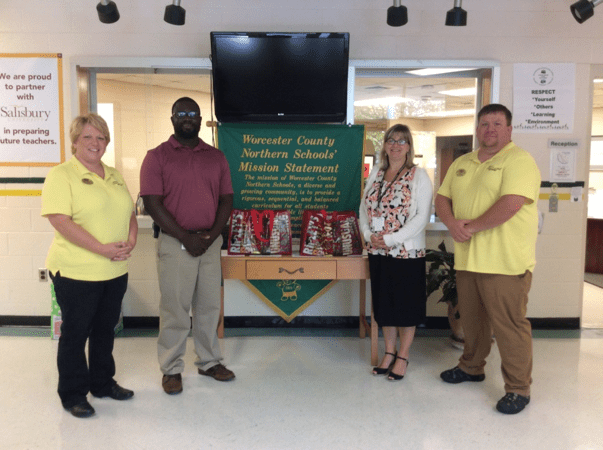 In picture (left to right): Audra Ely, Deshon Purnell – School Counselor Buckingham Elementary, Karen Marx – Principal Buckingham Elementary, Brandon Ely