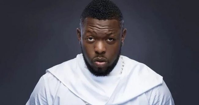 Timaya gets knocks for advising Phyno to impregnate a lady, shun marriage
