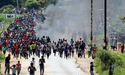 ZIMBABWE UNREST: Opposition leaders go into hiding as dissidents challenge clampdown in court