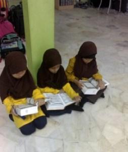 Reading Al - Quran during break time