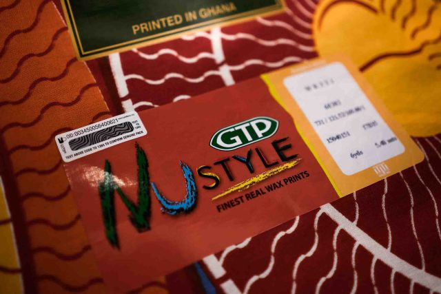 An MPedigree label on the GTP cloth sold in Owusu-Agyemang's store. Photographer: Nana Kofi Acquah