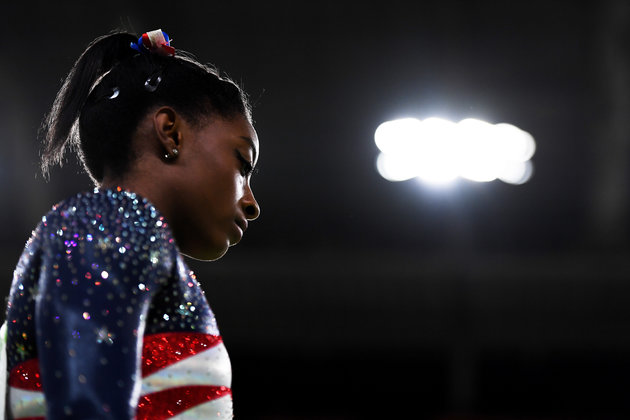 RIO DE JANEIRO, BRAZIL - AUGUST 09:  Simone Biles of the United States looks on before competing on the floor during the Artistic Gymnastics Women's Team Final on Day 4 of the Rio 2016 Olympic Games at the Rio Olympic Arena on August 9, 2016 in Rio de Janeiro, Brazil.  (Photo by Laurence Griffiths/Getty Images)